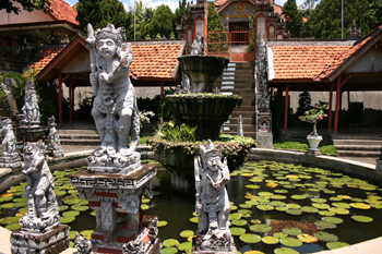 Lotus pads float in a fountain in front of the Brahmavihara Arama Buddhist Monastery