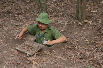 A guide shows us how the Viet Cong disappeared into a tunnel during the war