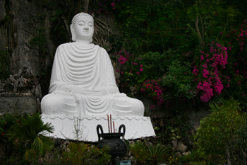 Giant Buddha perches on a hillside on top of Marble Mountain
