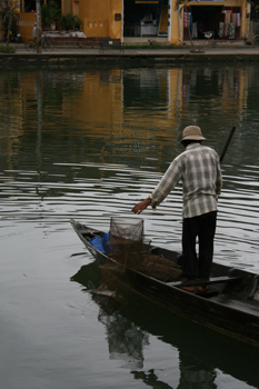 Fisherman lets out a fish creel on the canal