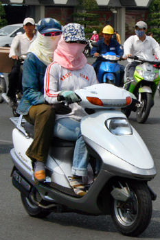 Vietnamese women cover themselves from head to toe as a protection from the sun