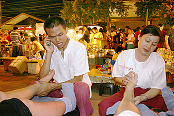 Getting a foot massage in the middle of the street in Chiang Mai