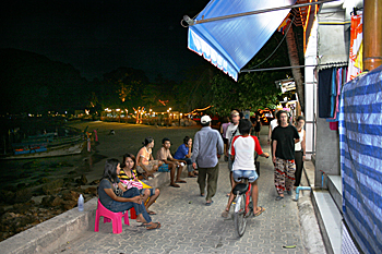 Strolling along the waterfront after dark on Phi Phi Don island Thailand