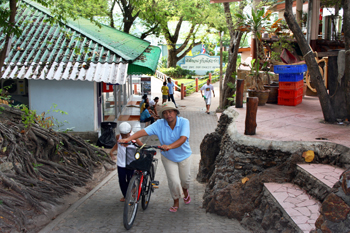 Since there are no cars on Phi Phi, most residents use bikes, walking them up the steeper parts of the paths