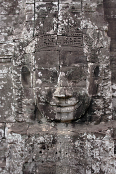 One of the enigmatic faces that adorn each of the four sides of every tower at Bayon