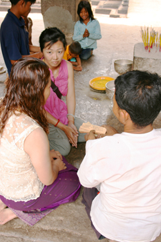 Visitors to Angkor Wat have their fortune told