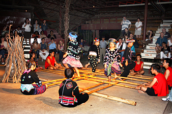 In this dance, children step-hopped in between lengths of bamboo that were being clacked together in time to the music