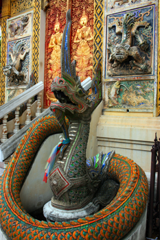The Vihara of Wat Ket Karam in Chiang Mai Thaiand is decorated with mirrored dragons that flank the staircases