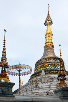 Wat Saen Fang in Chiang Mai Thailand features golden umbrellas, the symbol of Chiang Mai as well as of providing protection