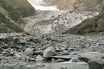 Near the foot of the Franz Josef glacier, boulders turn to big chunks of ice