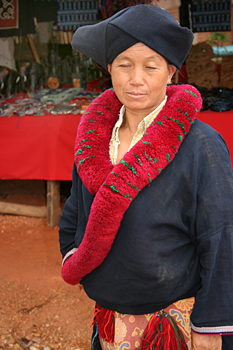 Yao (Mien) tribal woman in traditional dress, village in the hills above Chiang Mai