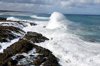 Waves crash onto 90-Mile Beach on the northern tip of New Zealand