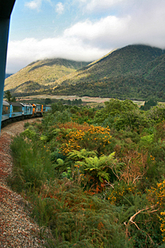 Leaning out the open-air observation platform on the TranzAlpine Express New Zealand