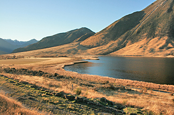 High mountain lake along the route of the TranzAlpine Railway New Zealand