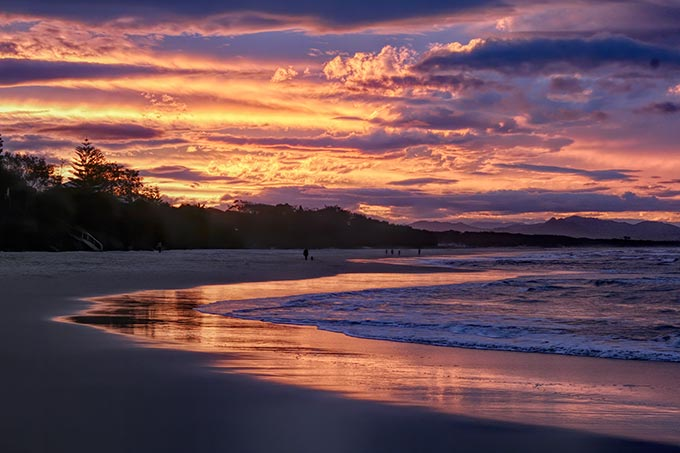 Vast stretches of beach in Byron Bay, Austalia, are famous for their white snads and stunning sunsets