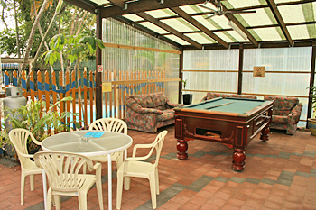 Pool table in the rear yard at Cairns City Backpackers Australia