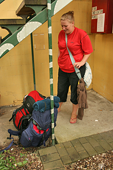 Backpackers carry huge packs Cairns Australia