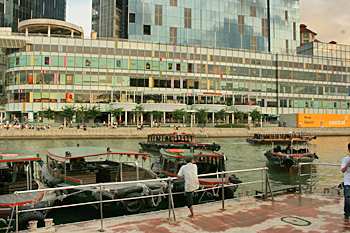 Bum boats ply the Singapore River