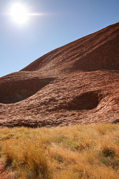 Sun climbs over Ayers Rock (Uluru) Australia