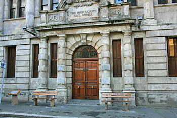 "Cape Town's High Court, with the ""Whites Only"" and ""Blacks Only"" benches from the apartheid era on display aside the entrance South Africa"