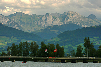 View of the Alps from Lake Zurich at the town of Rapperswil Switzerland