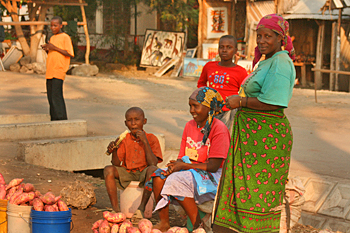 Women selling sweet potatoes on the streets of Mto wa Mbu Tanzania