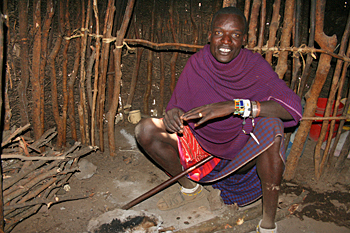 Maasai tribal elder inside traditional hut n Tanzania