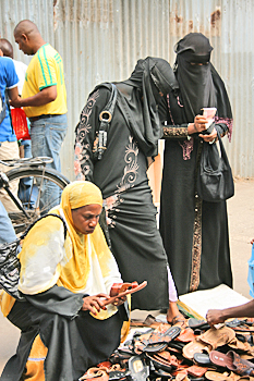 Some Muslim women in Zanzibar adopt the traditional dress with only their eyes visible