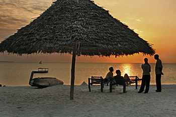 Enjoying the last rays from under the palapa on Zanzibar