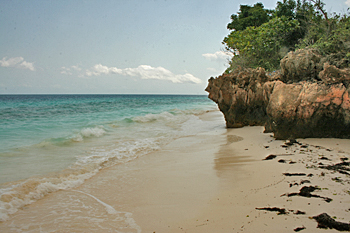 To visit the village of Nungwi on the island of Zanzibar you can walk the beach but you have to time the tide just right in order to get around this headland