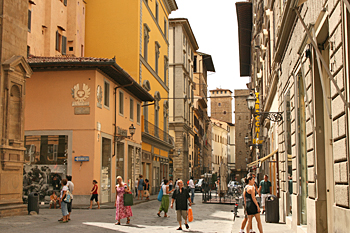 Shopping in the many designer stores that line the streets of Florence Italy