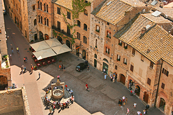 Looking at the wishing well from the top of the only tower that can be climbed in San Gimignano Italy