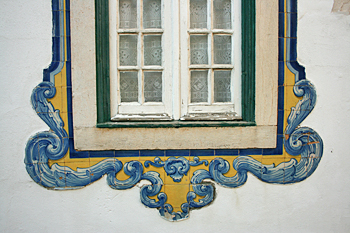 Azulejo tiles framing window in Cascais Portugal