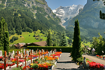 Church graveyard in Grindewald Switzerland has a perfect view for eternity