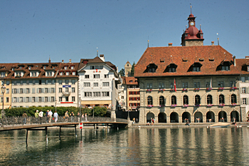 Bridge to Kornmarkt Square and the beautifully preserved City Hall in Lucerne Switzerland