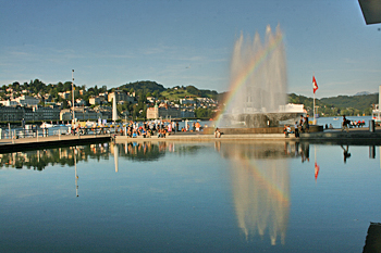 Fountain and rainbow in the reflecting pond at the Art Center in Lucerne Switzerland