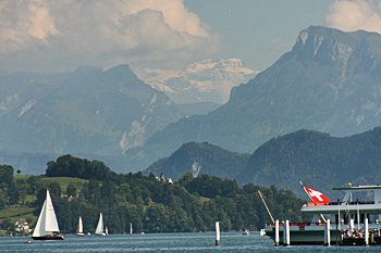 Snow-capped Alps tower over Lake Lucerne Switzerland