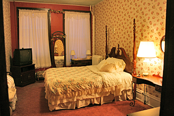 Nicely furnished room, Lowe Hotel, Point Pleasant, West Virginia