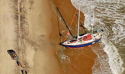 Sailboat beached on the Outer Banks, one mile south of the Avon Pier. Photo courtesy of Don Bowers and Island Press.