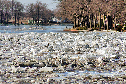 Backed-up ice pushes into the cove, creating a mini-glacier and flooding