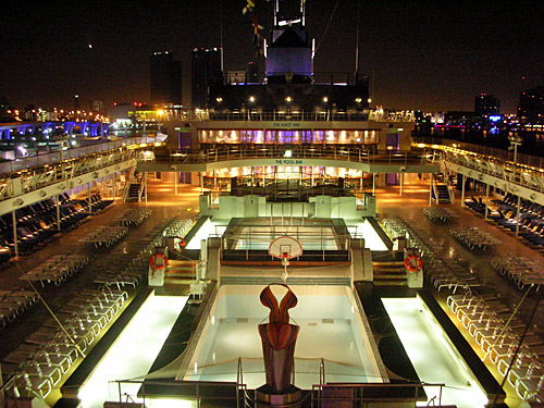 The pool deck on Celebrity Century at night, one of the many things you could enjoy on the cheap during a repositioning cruise