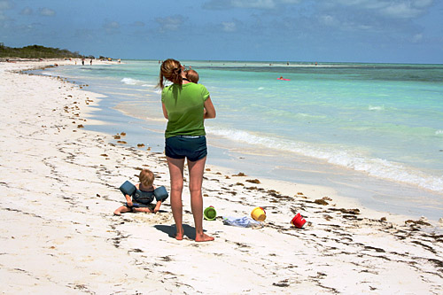 A young mother contemplates the loveliness of Sandspur Beach at Bahia Honda State Park