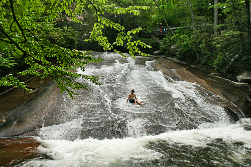 Riding the rapids at Sliding Rock, Pisgah National Forest, Brevard, North Carolina