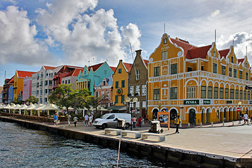 Colorful houses line the pier on the pier in Willemstad, Curacao