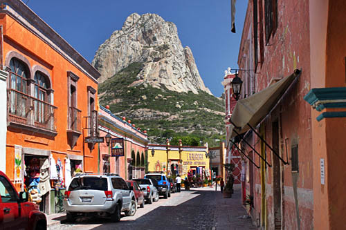 Pena de Bernal - third tallest monolithic rock in the world - towers over the tiny village of Bernal