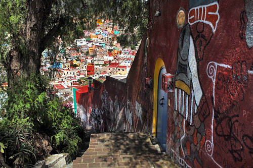 One path down leads past a giant wall mural