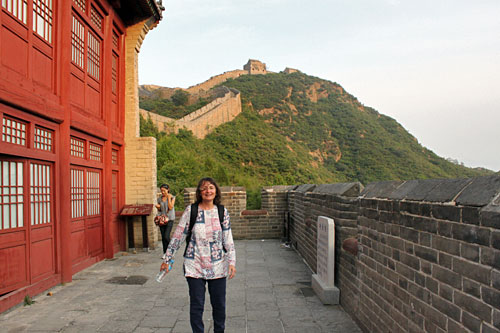 My cousin Loretta prepares to climb to the top of the Great Wall of China  to sleep there overnight