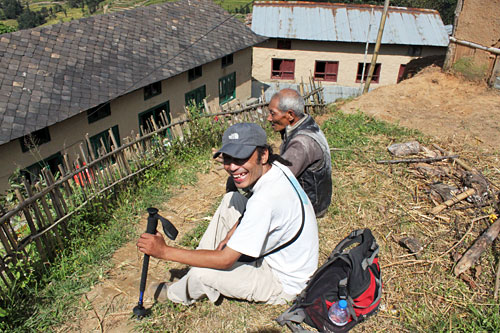 My guide chats with a Nepali farmer in the foothills during a break in our climb toward Nagarkot