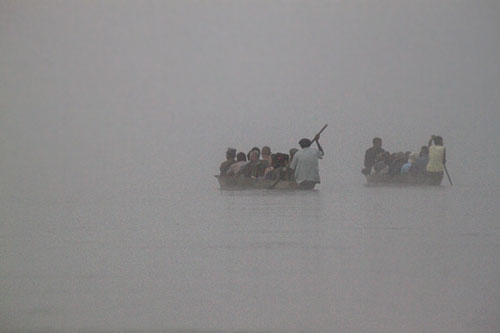 Canoes in front of us disappeared into the thick mists