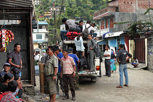 Overloaded 4WD jeeps carry passengers from Besisahar into the high mountain villages